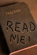 Dirty Bible with read me written on it